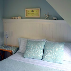 double bed with pillows and sweet dreams frame on wall